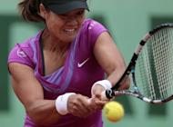 China's Li Na, pictured on June 4, admits she is relieved to be the forgotten woman at Wimbledon this year after an uncomfortable experience in the spotlight following her French Open triumph 12 months ago