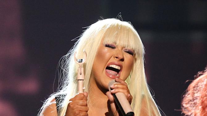 """Christina Aguilera performs """"Lotus"""", """"Army of Me"""" and """"Let There Be Love"""" at the 40th Anniversary American Music Awards on Sunday, Nov. 18, 2012, in Los Angeles. (Photo by Matt Sayles/Invision/AP)"""