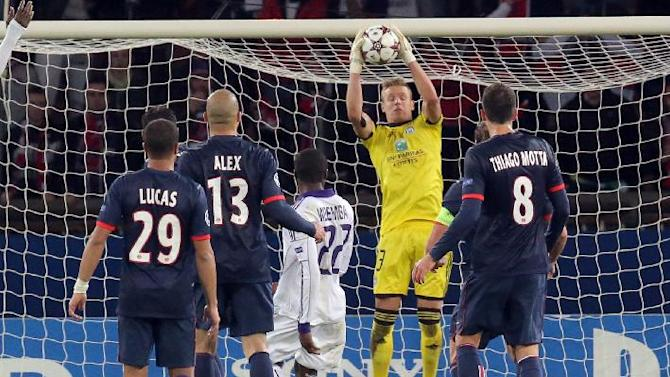 Anderlecht's goalkeeper Thomas Kaminski, center in yellow, makes a save during his Champions League group C soccer match against Paris Saint Germain in Paris, France, Tuesday, Nov. 5, 2013