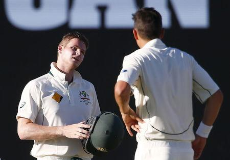 Australia's captain Steve Smith reacts after being hit in the helmet by a delivery from New Zealand's Trent Boult during the fourth day of the second cricket test match at the WACA ground in P