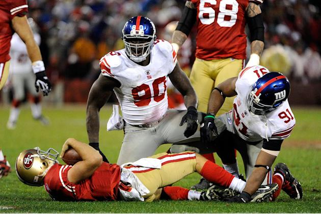 Jason Pierre-Paul #90 And Justin Tuck #91 Of The New York Giants React Afetr They Sacked Alex Smith #11 Of The San Getty Images