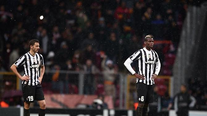 Juventus players react after losing their Champions League soccer match with Galatasaray at the TT Arena Stadium in Istanbul, Turkey, Wednesday, Dec. 11, 2013. The match was halted Tuesday in the 31st minute with the score at 0-0 as hail and snow began to fall heavily in Istanbul, but resumed Wednesday. (AP Photo)