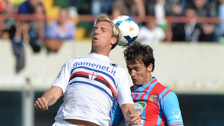 Sampdoria forward Maxi Lopez, left, of Argentina, jumps for the ball with Catania defender Nicola Legrottaglie during the Serie A soccer match between Catania and Sampdoria at the Angelo Massimino stadium in Catania, Italy, Saturday, April 19, 2014