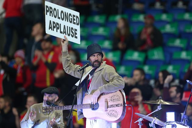 Gruff Rhys of the Super Furry Animals perform before the match
