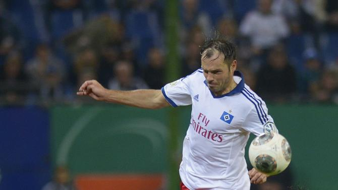 Hamburger SV's Westermann and Greuther Fuerth's Mavraj fight for ball during second round German soccer cup match in Hamburg,