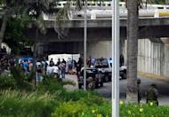 General view of the scene where 35 bodies were found at the Adolfo Ruiz Cortinez Blvd in Boca del Rio municipality, Veracruz State, Mexico, in September 2011. Ten more bodies have been found in the Mexican Gulf coast city of Veracruz, just a week after authorities found another 32 cadavers stashed in two homes, authorities said Saturday