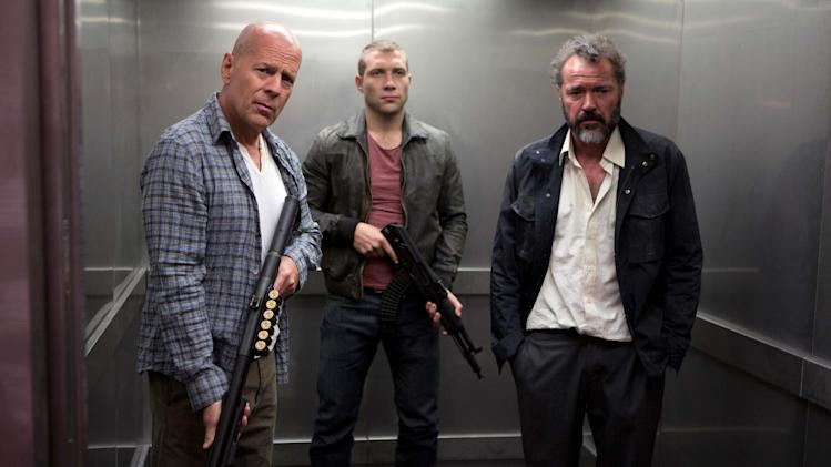"FILE - This publicity film image released by 20th Century Fox shows Bruce Willis as John McClane, left, Jai Courtney as his son Jack, center and Sebastian Koch as Komarov in a scene from ""A Good Day to Die Hard."" (AP Photo/20th Century Fox, Frank Masi, File)"