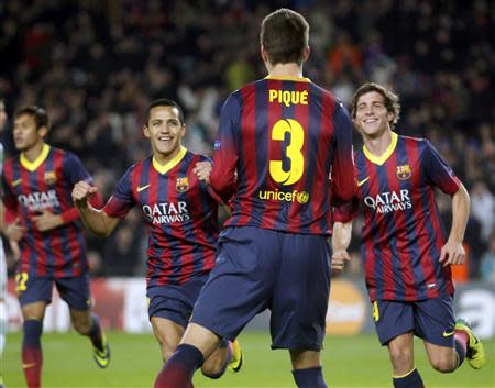 Barcelona's Pique is congratulated by team mates after scoring a goal against Celtic during their Champions League soccer match in Barcelona