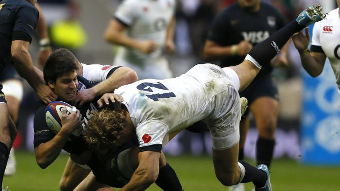 Argentina's Amorosino is tackled by England's Twelvetrees during their international rugby union match at Twickenham in London