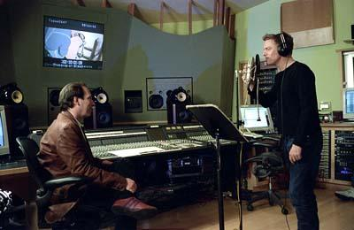 "Hans Zimmer and Bryan Adams record the song ""Get off My Back"" for Dreamworks' Spirit: Stallion of the Cimarron"