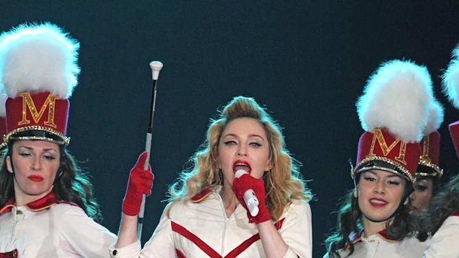 "U.S. singer Madonna, center, performs during her concert at Olympic Hall in Moscow, Russia, Tuesday, Aug. 7, 2012. Madonna has voiced hope that three feminist Russian rockers on trial for performing a ""punk prayer"" against Vladimir Putin are released soon. The pop star told the AP during her concert tour of Russia that she supports freedom of speech and hopes the judge will show leniency. (AP Photo/Mikhail Metzel)"