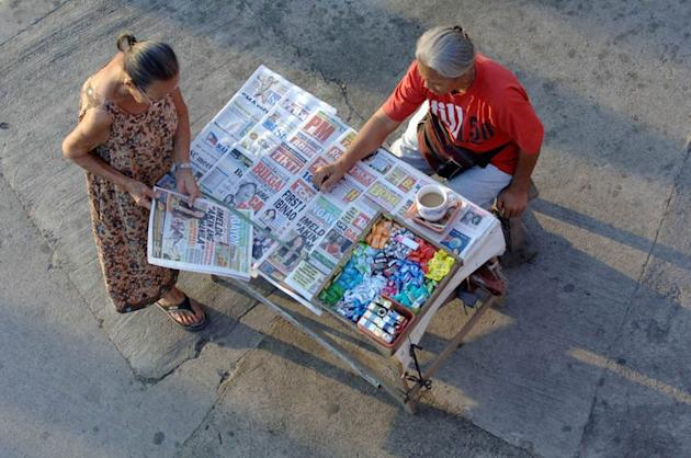 Illustration of a Manila newspaper vendor. One of the Philippines' most influential newspapers said Thursday it had suspended a popular comic strip for a homosexual joke that angered some conservatives in the mainly Catholic country