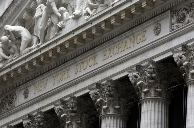 FILE - This Oct. 2, 2014 file photo shows the facade of the New York Stock Exchange, in New York. U.S. stocks are opening slightly higher Monday, March 2, 2015, as investors focused on earnings and de