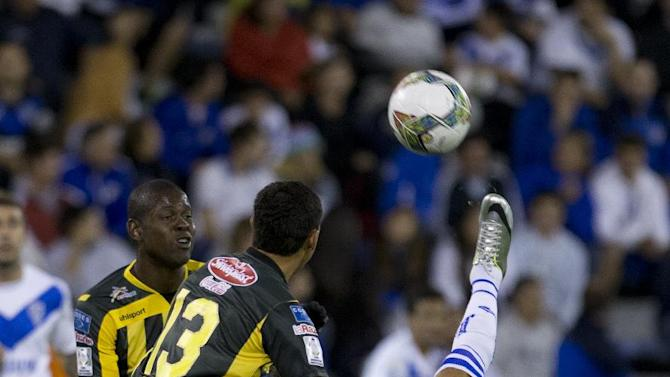 Mauro Zarate of Argentina's Velez Sarsfield, right, kicks the ball past Enrique Parada of Bolivia's The Strongest, 13, and Jefferson Lopes during a Copa Libertadores soccer match in Buenos Aires, Argentina, Tuesday, March 18, 2014