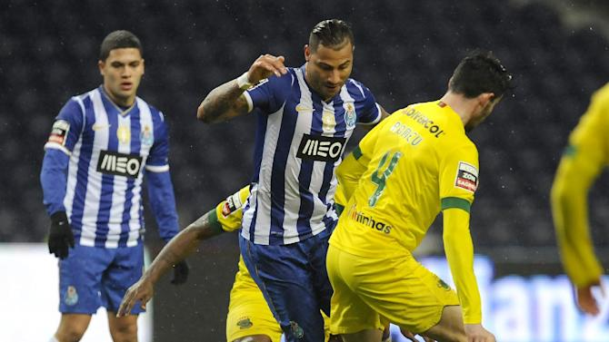 FC Porto's Ricardo Quaresma, centre, drives the ball past Pacos Ferreira's Romeu Rocha, right, and Jean Seri, from Ivory Cost, with Juan Quintero from Colombia at left, in a Portuguese League soccer match at the Dragao stadium in Porto, Portugal, Sunday, Feb. 9, 2014. Quaresma scored once in Porto's 3-0 victory