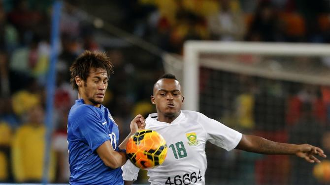 Brazil's Neymar is challenged by South Africa's Ayanda Fatosi during their international friendly soccer match at the First National Bank (FNB) Stadium, also known as Soccer City, in Johannesburg