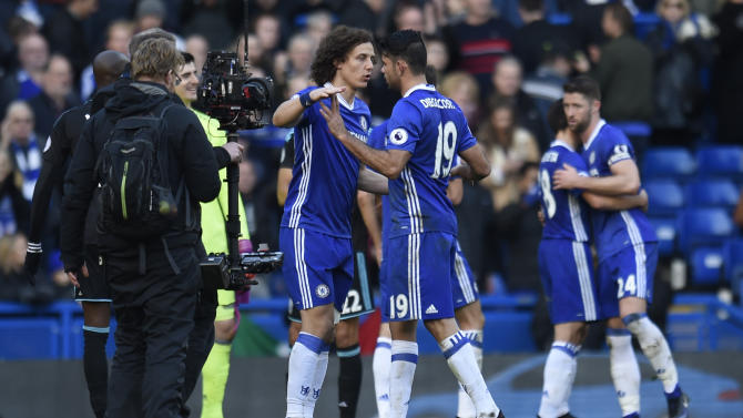 Chelsea's David Luiz celebrates after the game with Diego Costa
