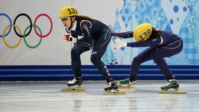 South Korea's Kong Sang-jeong is pushed by teammate Shim Suk-Hee during the women's 3,000 metres short track speed skating semi-finals relay race at the Iceberg Skating Palace during the 2014 Sochi Winter Olympics