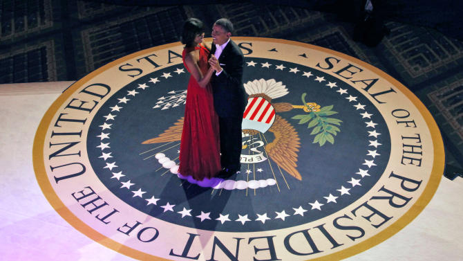 President Barack Obama and first lady Michelle Obama dance at the Commander-in-Chief's Inaugural Ball in Washington, at the Washington Convention Center during the 57th Presidential Inauguration Monday, Jan. 21, 2013. (AP Photo/Pablo Martinez Monsivais)