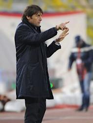 FC Juventus' coach Antonio Conte gestures to players during their Serie A match against Bologna. Juventus maintained their unbeaten run this season but fell behind AC Milan in the Serie A title race following a 1-1 draw at Bologna on Wednesday