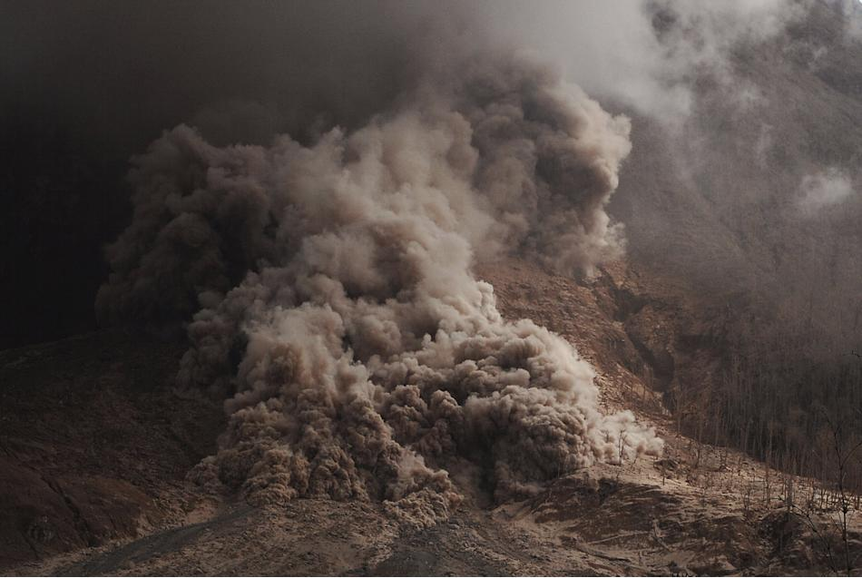 Hot ash as seen during an eruption of Mount Sinabung in Karo Regency