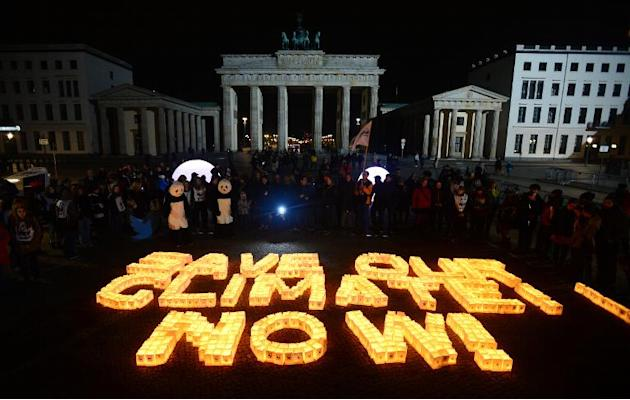 "Candles in paper bags are placed to form the lettering ""Save our climate, Now"" in Berlin during the global climate change awareness campaign ""Earth Hour"" on March 28, 2015"
