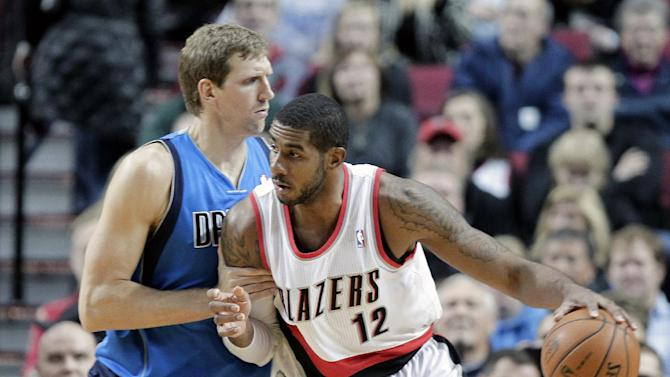 Portland Trail Blazers forward LaMarcus Aldridge, right, works the ball in on Dallas Mavericks forward Dirk Nowitzki, from Germany, during the first half of an NBA basketball game in Portland, Ore., Saturday, Dec. 7, 2013