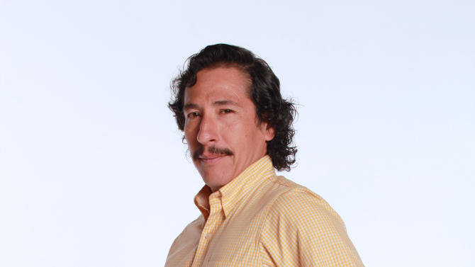 """FILE - In this 2012 promotional file photo provided by RCN Television, actor Elkin Diaz poses in character as Vicente Castano for the television series """"Tres Caines,"""" or """"Three Cains,"""" an allusion to the Biblical story of Cain slaying his brother Abel, in Bogota, Colombia.  The soap opera has stirred unprecedented controversy by dramatizing _ and some say romanticizing _ the career of the Castano brothers, central figures in the creation of the country's murderous far-right militias. (AP Photo/RCN Television, File)"""