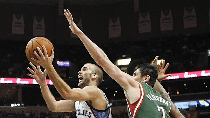 Memphis Grizzlies guard Nick Calathes (12) drives to the basket against Milwaukee Bucks forward Ersan Ilyasova (7), of Turkey, in the second half of an NBA basketball game on Saturday, Feb. 1, 2014, in Memphis, Tenn. The Grizzlies won 99-90