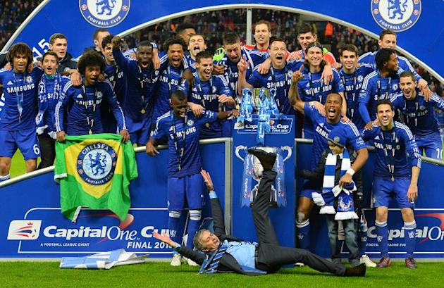 Chelsea's Portuguese manager Jose Mourinho celebrates with his team after Chelsea won the League Cup final match against Tottenham Hotspur at Wembley Stadium in London on March 1, 2015