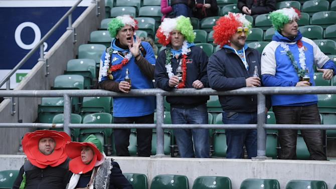 Italy fans wearing wigs and England fans in fancy dress before the game
