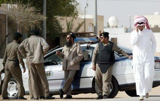 Saudi security personnel stand guard near Riyadh. Dozens of protesters in Riyadh called for the release or immediate trial of imprisoned Islamist relatives