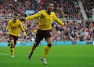 Arsenal midfielder Santi Cazorla (R) celebrates after scoring the opening goal during the match against Sunderland in Sunderland, February 9, 2013. Arsenal on Saturday will have to be on their guard against Championship side Blackburn