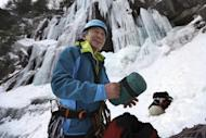 In this Sunday, Feb. 6, 2017 photo, Yuki Fujita, 69, packs his gear after a uplifting day of ice climbing on Frankenstein Cliff in Hart's Location, N.H. Fujita, of Southwick, Mass., was among the the first wave of ice climbers to ascend Frankenstein in the 1970s. (AP Photo/Robert F. Bukaty)