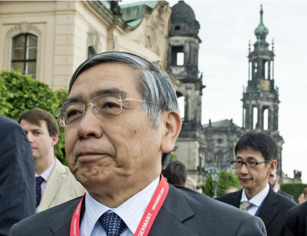 Haruhiko Kuroda, Governor of the Bank of Japan, smiles on his way to visit the Frauenkirche cathedral (Church of Our Lady) in Dresden, eastern Germany, Wednesday, May 27, 2015. The G7 Finance Minister