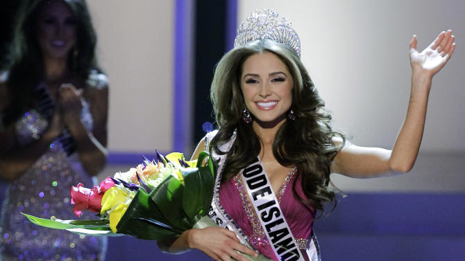Miss Rhode Island Olivia Culpo waves to the audience after being crowned Miss USA during the 2012 Miss USA pageant, Sunday, June 3, 2012, in Las Vegas. (AP Photo/Julie Jacobson)