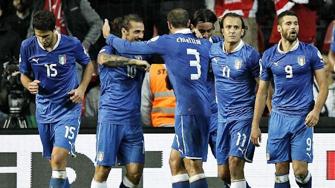 Italy's Andrea Ranocchia, Daniel Osvaldo Pablo, Giorgio Chiellini, Alberto Gilardino and Antonio Candreva celebrate after the team's second goal, during the 2014 World Cup Group B qualifying soccer match between Denmark and Italy at Parken Stadium in Copenhagen, Denmark, Friday Oct. 11, 2013