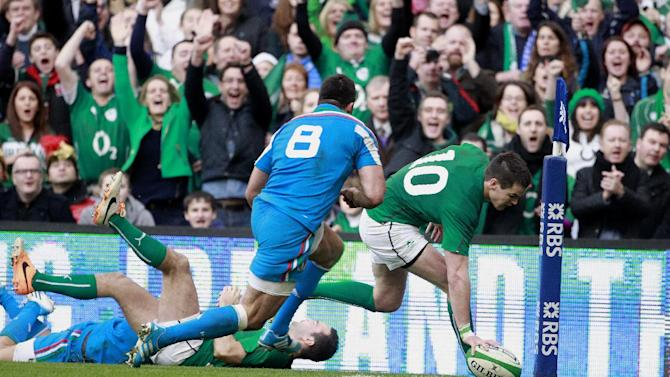 Ireland's Jonathan Sexton, right, scores a try against Italy during their Six Nations Rugby Union international match at the Aviva Stadium, Dublin, Ireland, Saturday, March 8, 2014. (AP Photo/Peter Morrison)