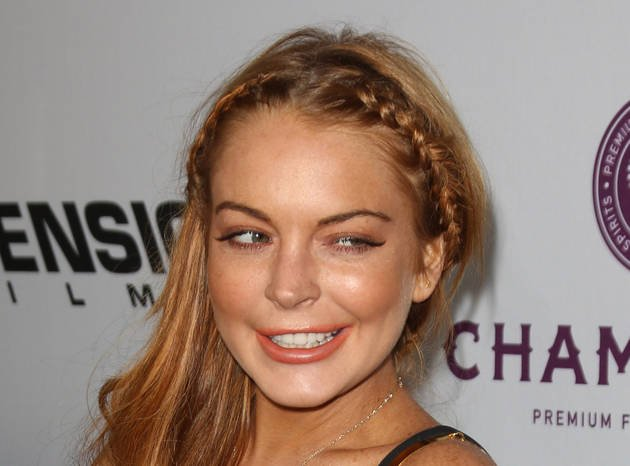 Lindsay Lohan denies wine-grabbing incident