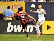 Cristiano Ronaldo (right) clashes with AC Milan's Mattia De Sciglio in a friendly at Yankee Stadium in New York last week. Real Madrid won 5-1