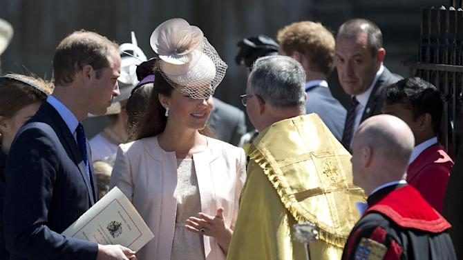 Britain's Prince William, left, and his wife Kate, Duchess of Cambridge, talk to the Dean of Westminster Abbey, Dr John Hall, as they leave following a service to celebrate the 60th anniversary of the coronation of Britain's Queen Elizabeth II at Westminster Abbey, London, Tuesday, June 4, 2013. (AP Photo/Alastair Grant)