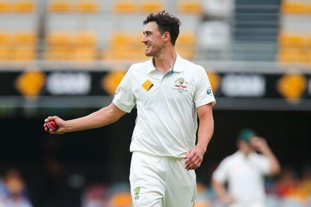 Australian bowler Mitchell Starc walks back to his mark, during the first cricket test match between Australia and New Zealand in Brisbane