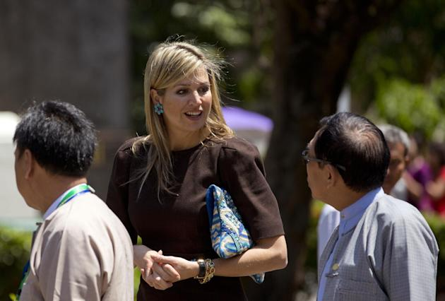 Queen Maxima of the Netherlands speaks with unidentified Myanmar lawmakers and educationalists after delivering a speech on the importance of access to financial services at the University of Yangon,