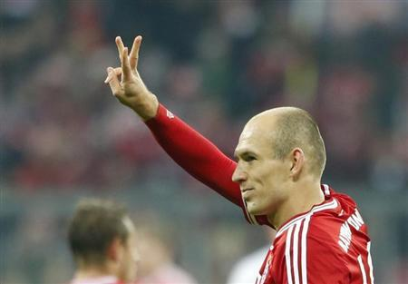 Bayern Munich's Robben celebrates a goal during their German Bundesliga first division soccer match against Schalke 04 in Munich