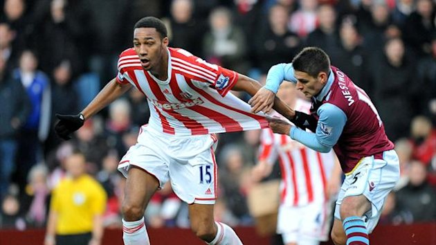 Aston Villa's Ashley Westwood (right) holds back Stoke City's Steven N'Zonzi