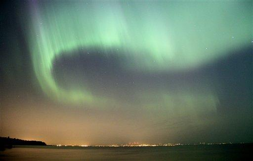 The northern lights fill the sky over the south shore of Lake Superior east of Superior, Wis. above Duluth, Minn., early Sunday, July 15, 2012. A solar storm sparked the spectacular northern lights di