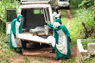 Health workers carry the body of an Ebola virus victim in Kenema, Sierra Leone. The Ebola outbreak has killed 467 people in Guinea, Liberia and Sierra Leone since February