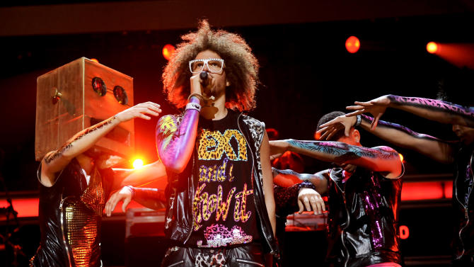 """FILE - In this Dec. 9, 2011 file photo, singer RedFoo, center, and LMFAO perform at Z100's Jingle Ball concert at Madison Square Garden in New York. When LMFAO released its sophomore album, """"Sorry for Party Rocking,"""" it only sold 27,000 units in its first week. But almost a year later, the album is approaching platinum status thanks to the monster hits """"Party Rock Anthem"""" and """"Sexy and I Know It,"""" and fans connecting more with the wild, party-boy vibe of the duo. (AP Photo/Evan Agostini, file)"""