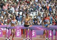 (From left) Britain's Jessica Ennis, Belgium's Sara Aerts and Russia's Tatyana Chernova compete in the women's heptathlon 100m hurdles heats at the athletics event during the London 2012 Olympic Games. Ennis made a flying start to the heptathlon as the London Games athletics programme got under way in front of a vocal, 80,000-capacity Olympic Stadium crowd