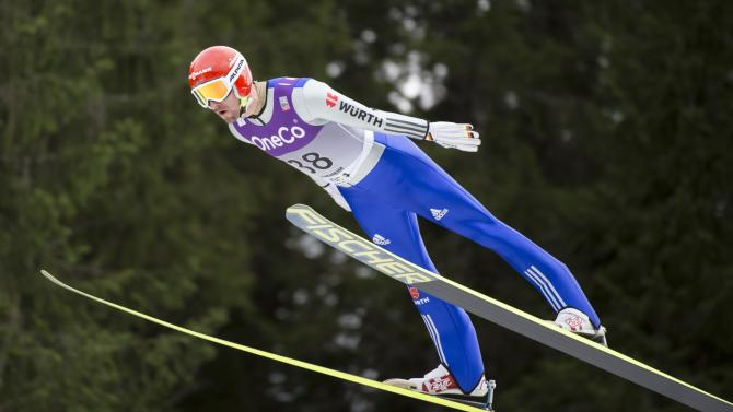 Bjoern Kircheisen of Germany soars through the air during the WC Nordic combined competition in Trondheim